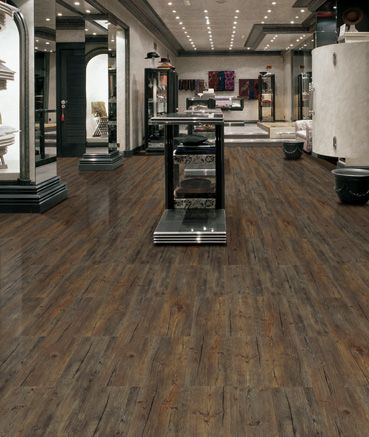 Luxury vinyl tile looks like hardwood with much better for Commercial hardwood flooring