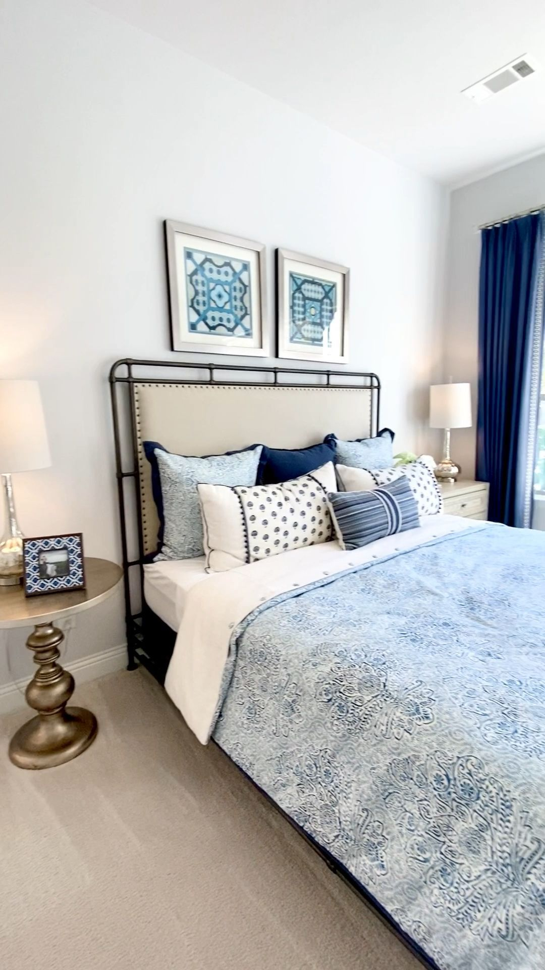 home decor videos #homedecor Master bedroom design with light and navy blue accents. Click to see more model home photos and decorating inspiration... Learn how to decorate or stage your own home... THE DECORATING COACH #decoratingideas #homestaging #bedroomideas