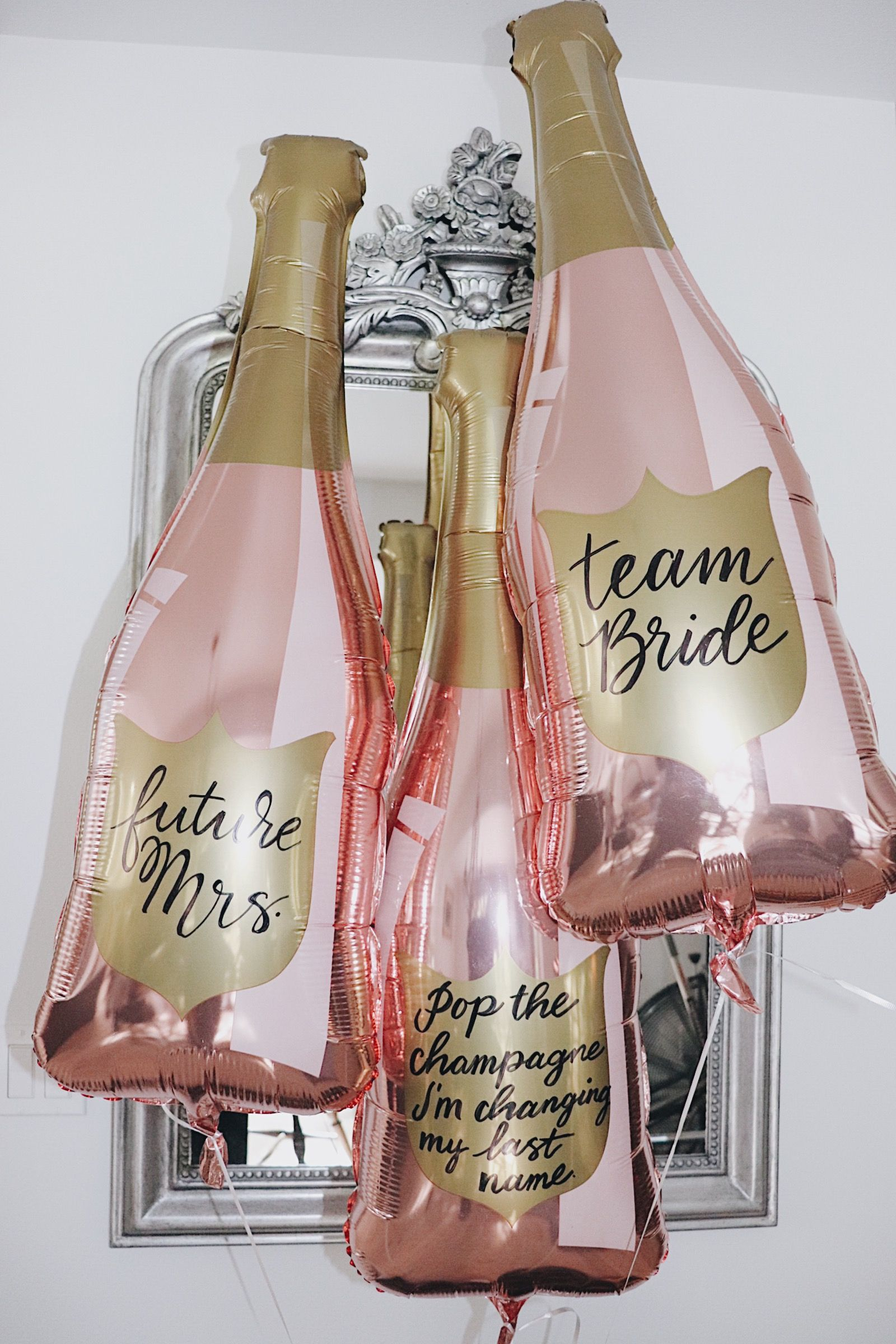 Shop Paper Confetti's exclusive customizable 36-inch rose gold champagne bottle balloon.  :: Team Bride. Future Mrs. Pop The Champagne I'm Changing My Last Name. Champagne Bottle Balloon. Rose Gold Balloons. Bachelorette Party. Bachelorette Party Supplies. Bridal Shower Decorations. Bachelorette Party Decorations. #decorationengagement