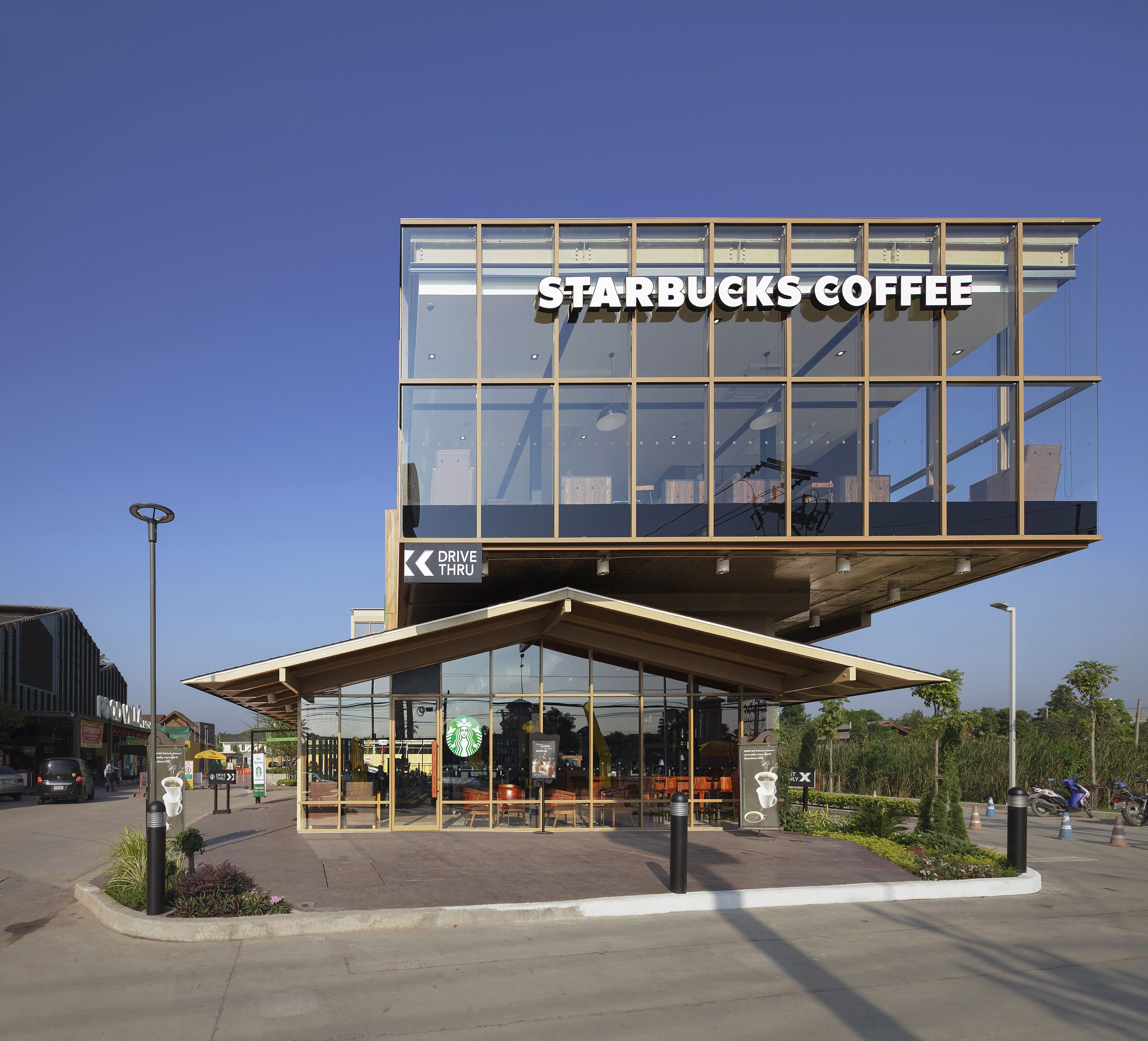 Starbucks Food Villa Is Located At Market Ratchapruek Bangkok The Building 2 Story Steel Structure Features Drive Thru Bar Seating On