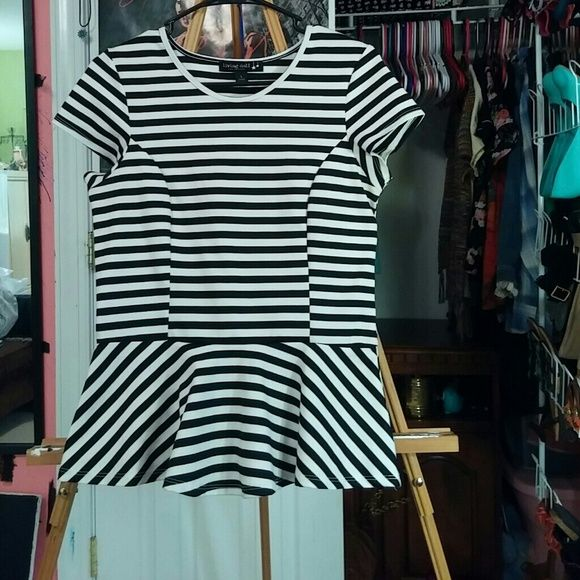 Stripe Peplum Top Black and white stripe peplum top from Living Doll. Only worn a few times and has some thread beading by the arms. Living Doll Tops Blouses