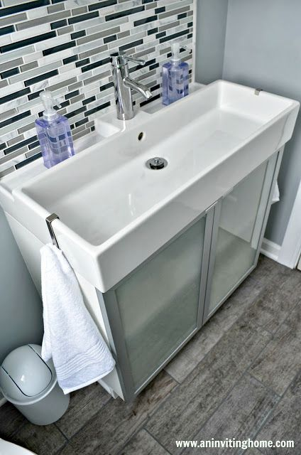 Modern Ikea Double Sink With Towel Hooks On Both Ends And