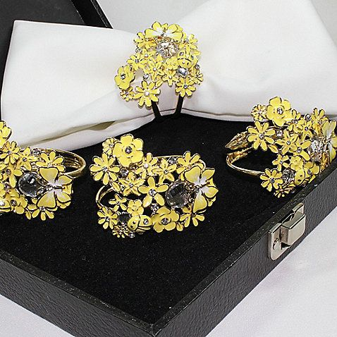 Bring spring to your table year-round with these Carmona NY napkin rings. Feminine, romantic, and sweet, the clusters of little yellow blooms make these napkin rings perfect for any occasion.