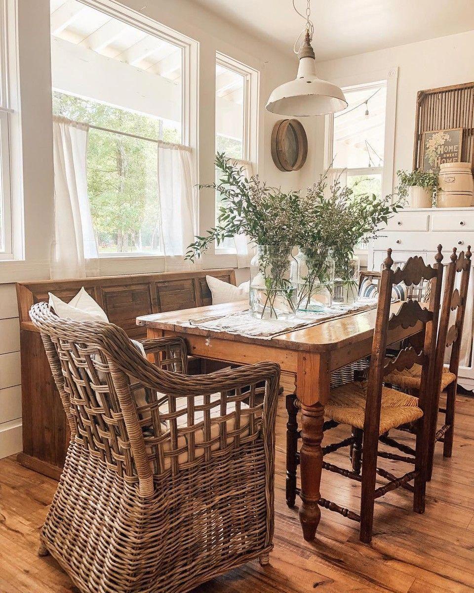 @whitetailfarmhouse #olivebranch #farmhousedining #lightfixture #woodentable #hardwoodfloors #farmfresh #diningroomdecor
