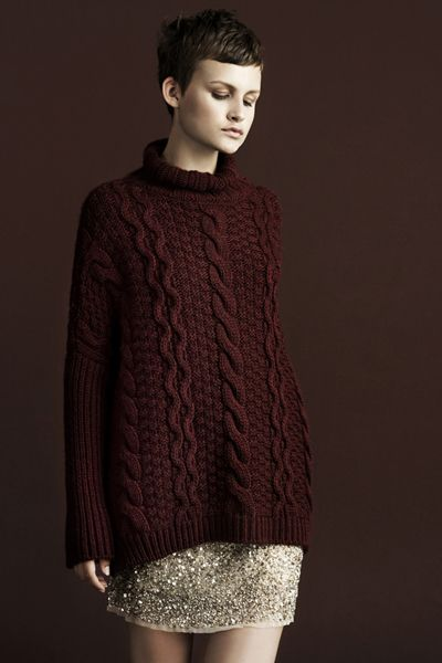 If I could pull off this look I would love the oversized cable sweater with an embellished mini!