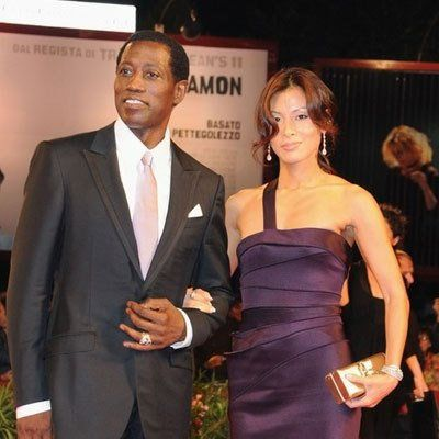 Interracial couple: American actor Wesley Snipes and his wife Nikki Nakyung Park #interracialcouple #interracialdating