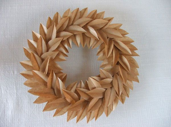 Kraft paper taped to a cardboard ring.  Who knew found objects could be so beautiful?