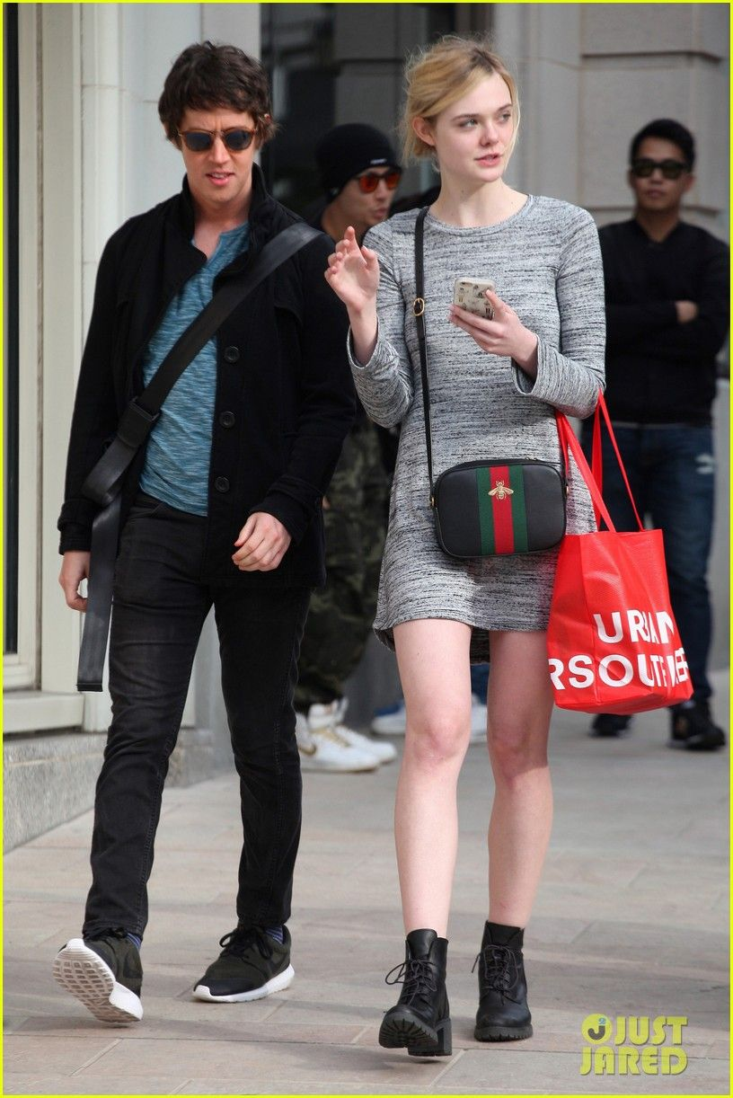 Elle Fanning enjoys leisurely stroll in the park with