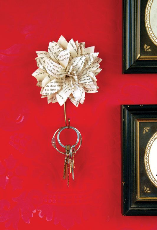 flower key holder. the flower alone is so fun! Made out of old book pages.