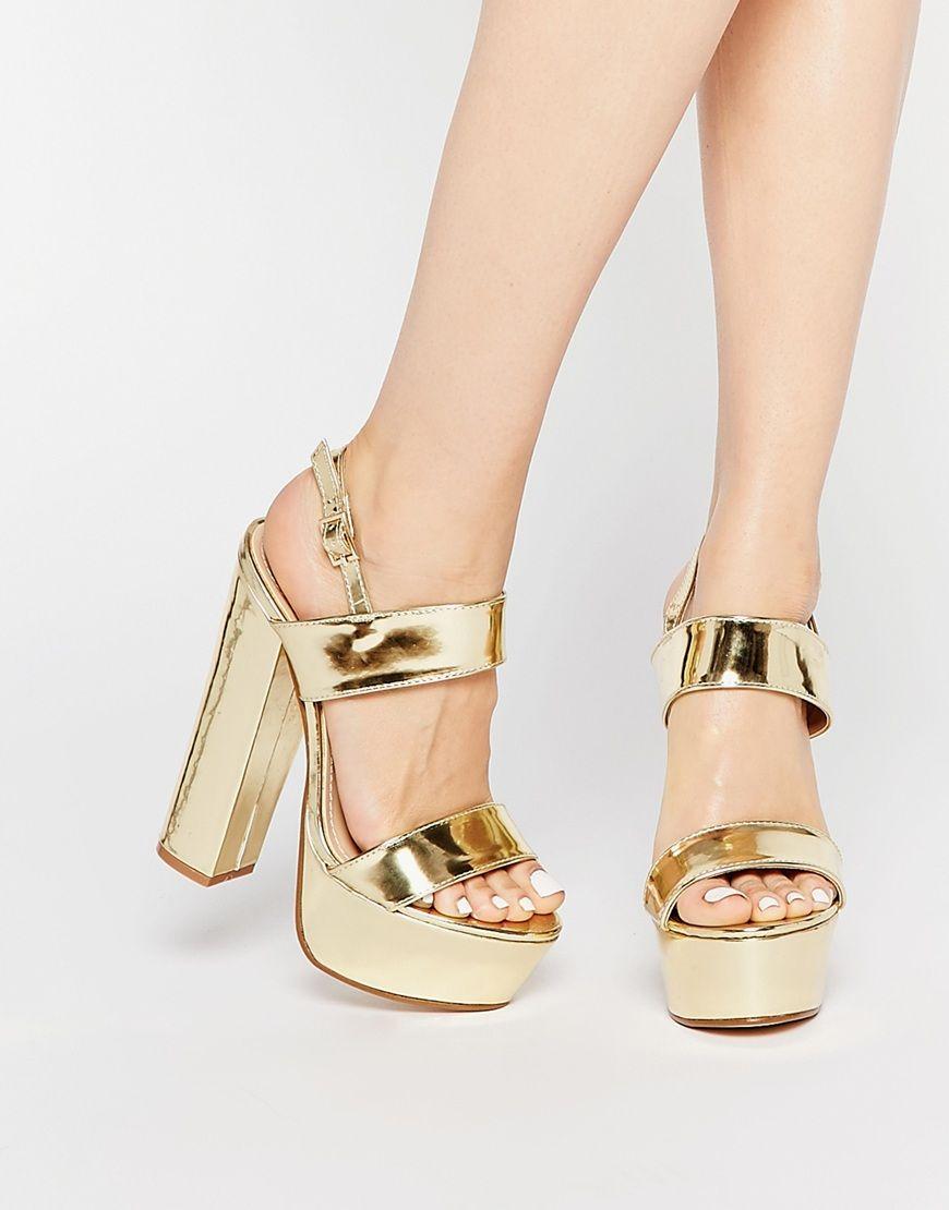 Sandalias de tacón de plataforma en dorado Shakira de Public Desire 42,99 €