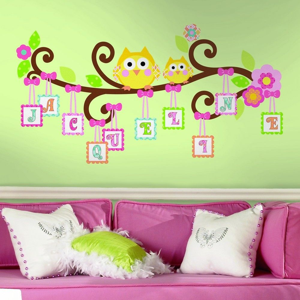 Lovely unisex kids room with pink bed and white cushions and green wall decor amipublicfo Gallery