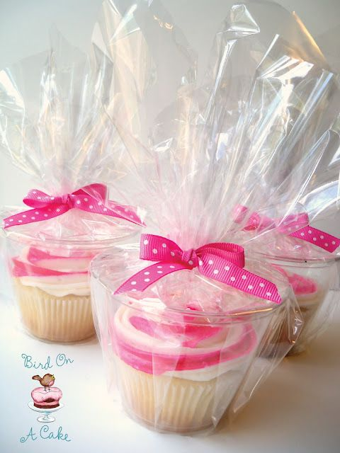 Simple way to package cupcakes for guests to take home. 9 oz plastic cups, cellophane, and a ribbon.