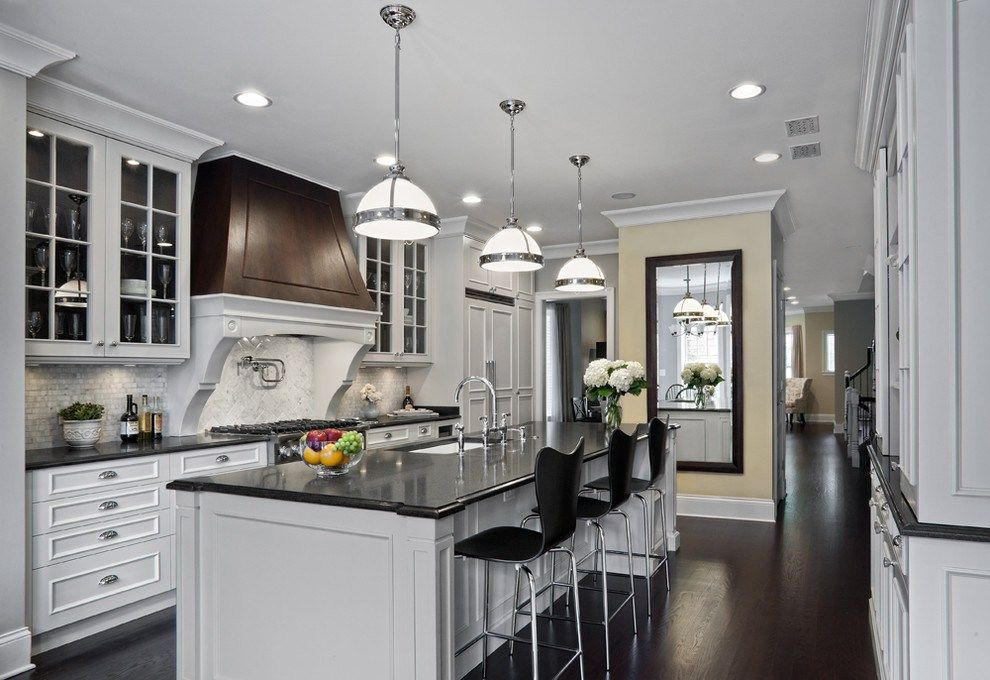 Chic Carrera Marble Convention Chicago Traditional Kitchen Decorators With Beverage Cooler Black Counters Counter S Home White Kitchen Design Black Countertops