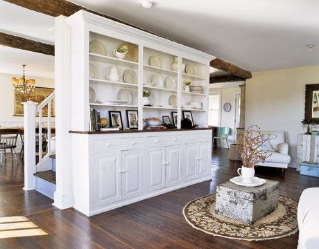 Six walls were removed to create an open floor plan on the lower level. Minimizing structural distractions frees the home to serve as a gallery of personal treasures.
