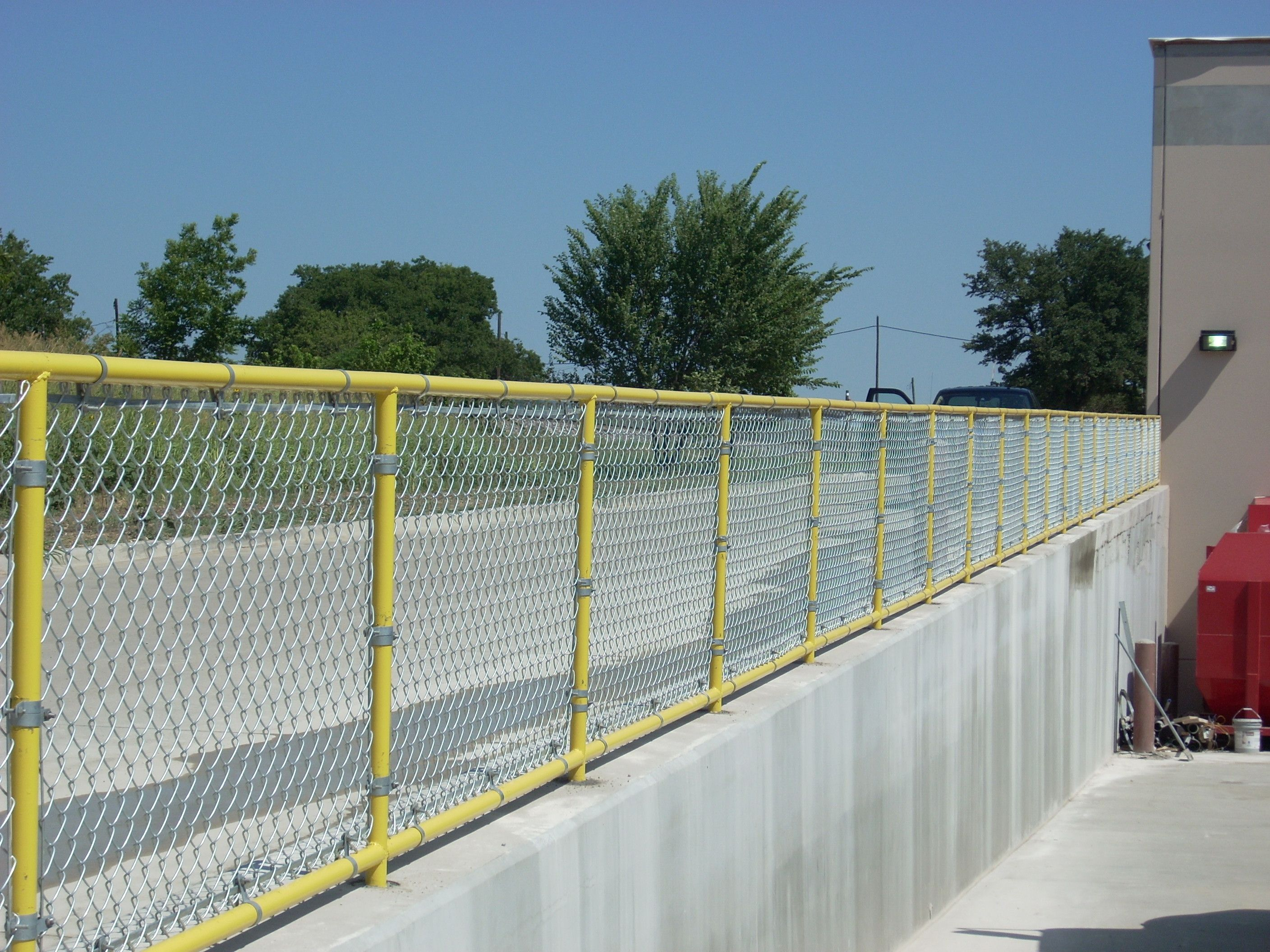 Galvanized Chain Link Rail Installed by Titan Fence & Supply