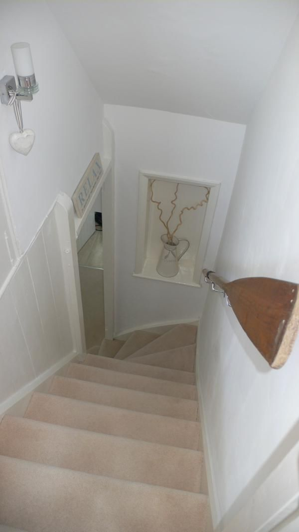 Great idea for a hand stair rail - use an Oar.