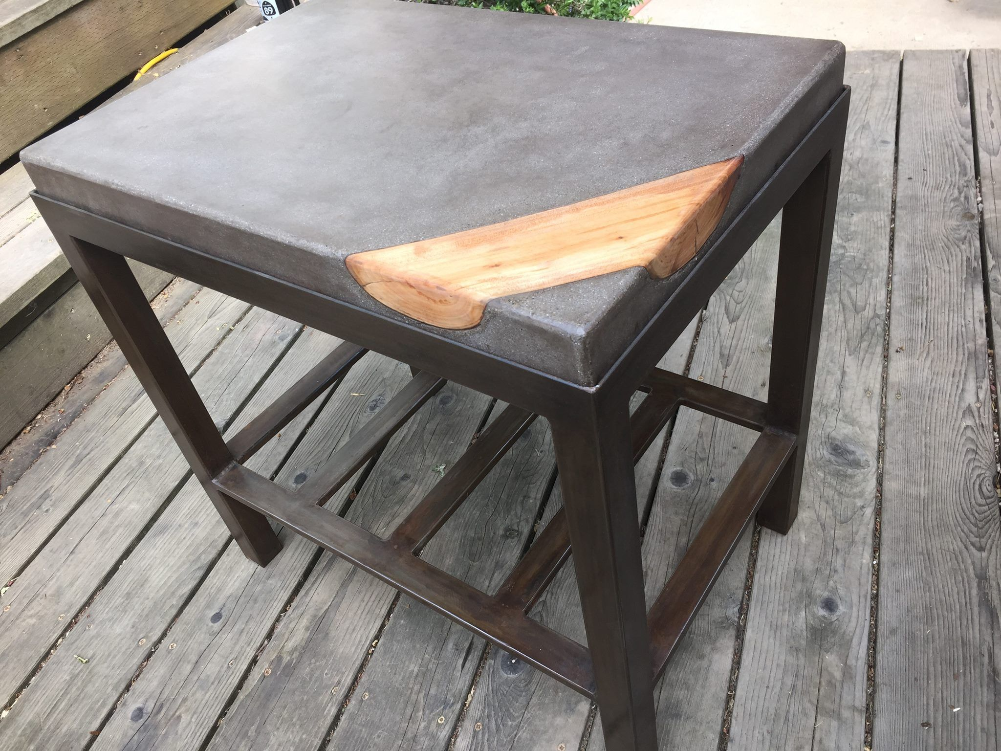 Concrete coffee table with wood inlay and metal base