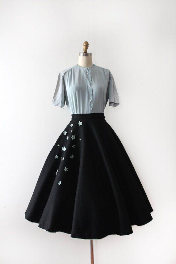 edb40ce33e880 Wonderful black felt circle skirt from the 1950s. This skirt has a fitted  waistline, a full circle skirt, rhinestone studded 3D stars along the side  in blue ...