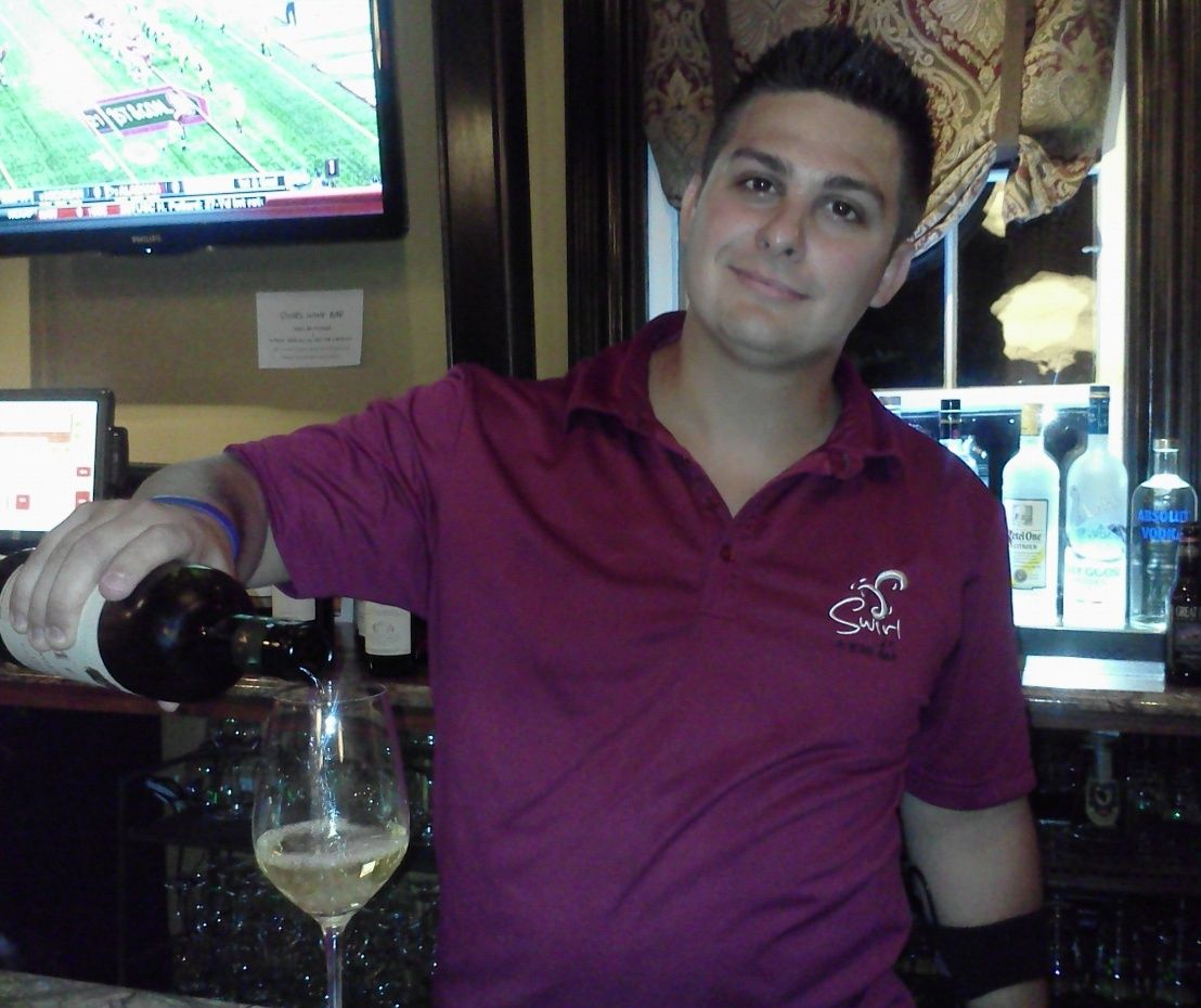 Eric K., a 2012 grad showing us his best wine move at Swirl Wine Bar in Solon,OH.When in a wine bar.