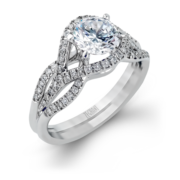 ZR487- This beautiful 14K white gold engagement ring comes with a fitted band and twists with a beautiful array of .34ctw of white diamonds.