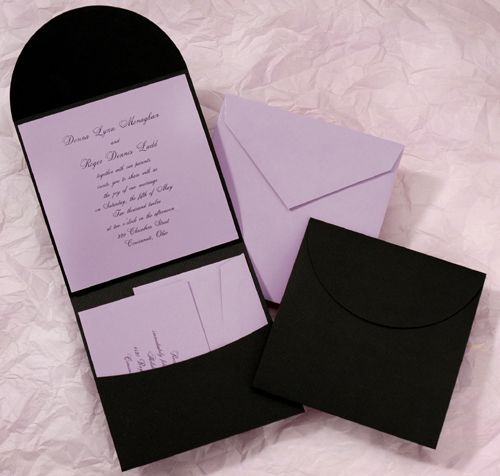 This lilac invitation and accessories are wrapped up in a black