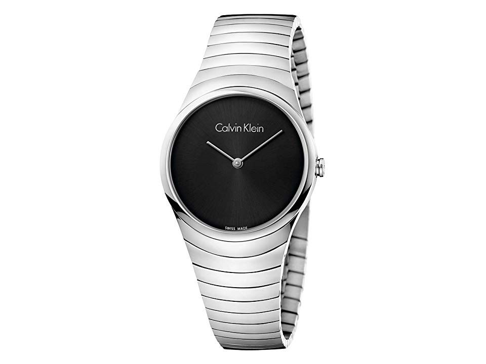 Calvin Klein Whirl Watch - K8A23141 (Black/Silver) Watches. Go for a ride around town with the Calvin Klein Whirl Watch - K8A23141. Stainless steel case. Stainless steel bracelet with fold-over  double push-button release. Round face. Two-hand analog display with quartz movement. Dial features silver-tone hands and Calvin Klein detailing. Crystal-embellished bezel. Water resistant to 3 bar. Display case included. Swiss Made. M
