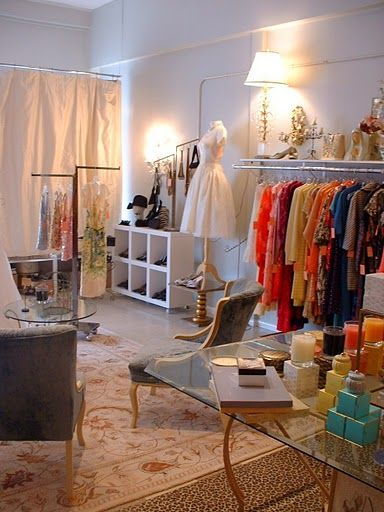 I like the idea of using a curtain hanging in front of window store front Boutique Design