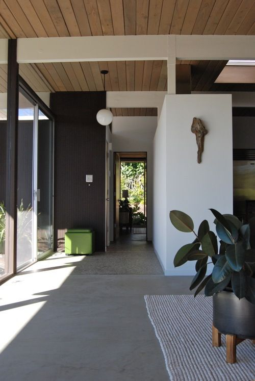 A mid century modern eichler original entry foyer for Eichler flooring