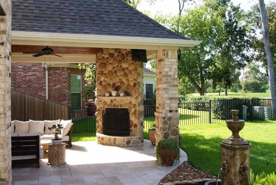 Light Colors Fieldstone Corner Fireplace On Covered Patio Yard