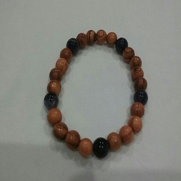 Selling this Wood and purple quartz bracelet in my Poshmark closet! My username is: karpediem22. #shopmycloset #poshmark #fashion #shopping #style #forsale #Jewelry