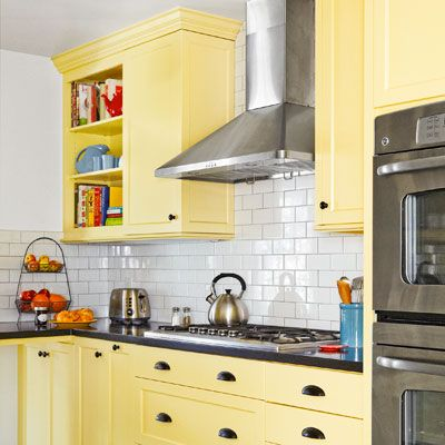 After Kitchen Redo Yellow Cabinets With Solid Surface Countertop Mimic Soapstone White Subway Tile