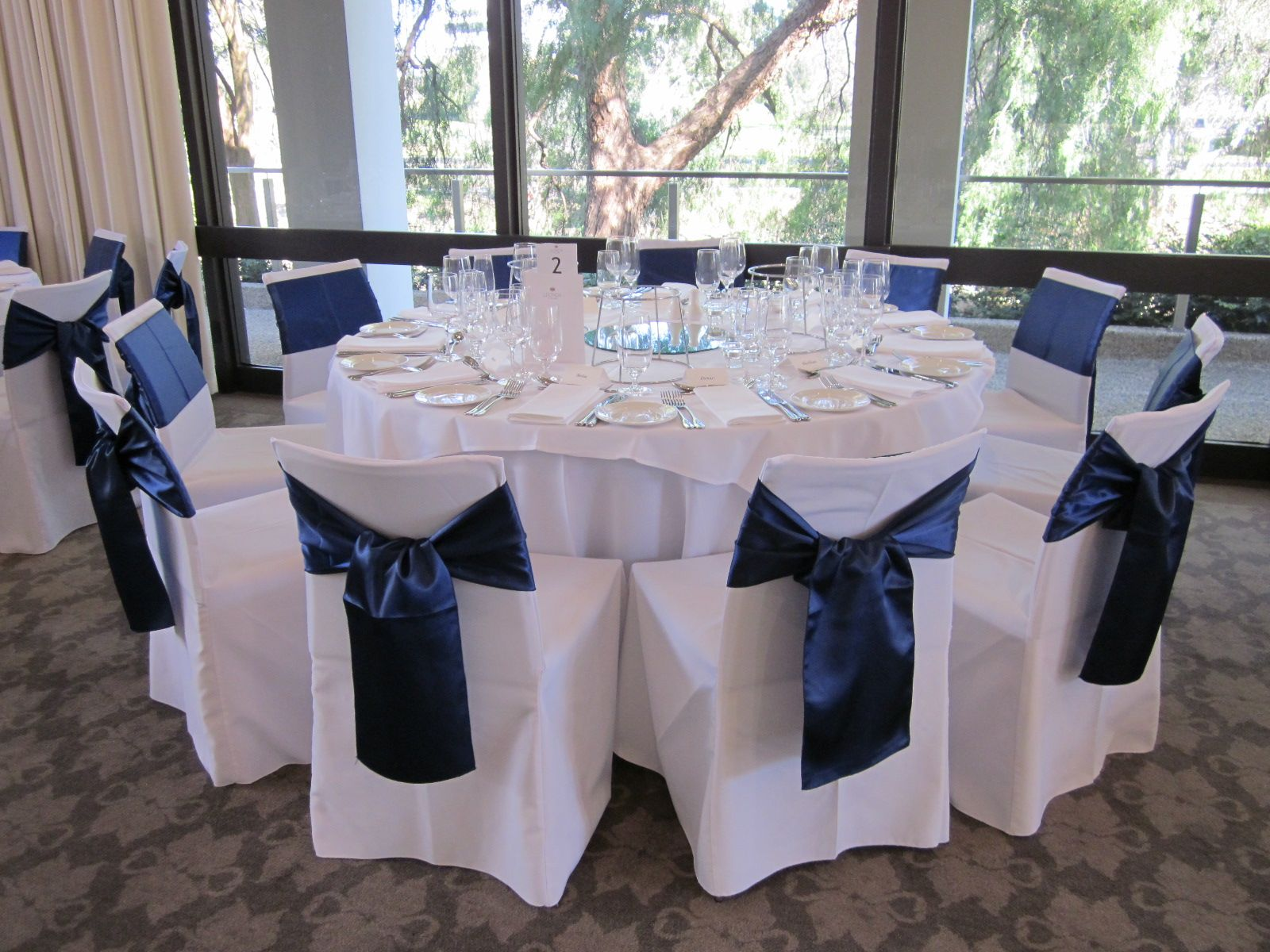 White Chair Covers With A Navy Blue Satin Sash Bouquet Melbourne