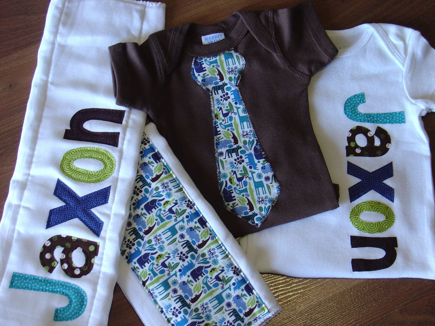 Boys Personalized Onesie and Burp Cloth Set, Perfect for Baby Shower Gift or Decoration - 2D Zoo, Jungle Animals. $45.00, via Etsy.