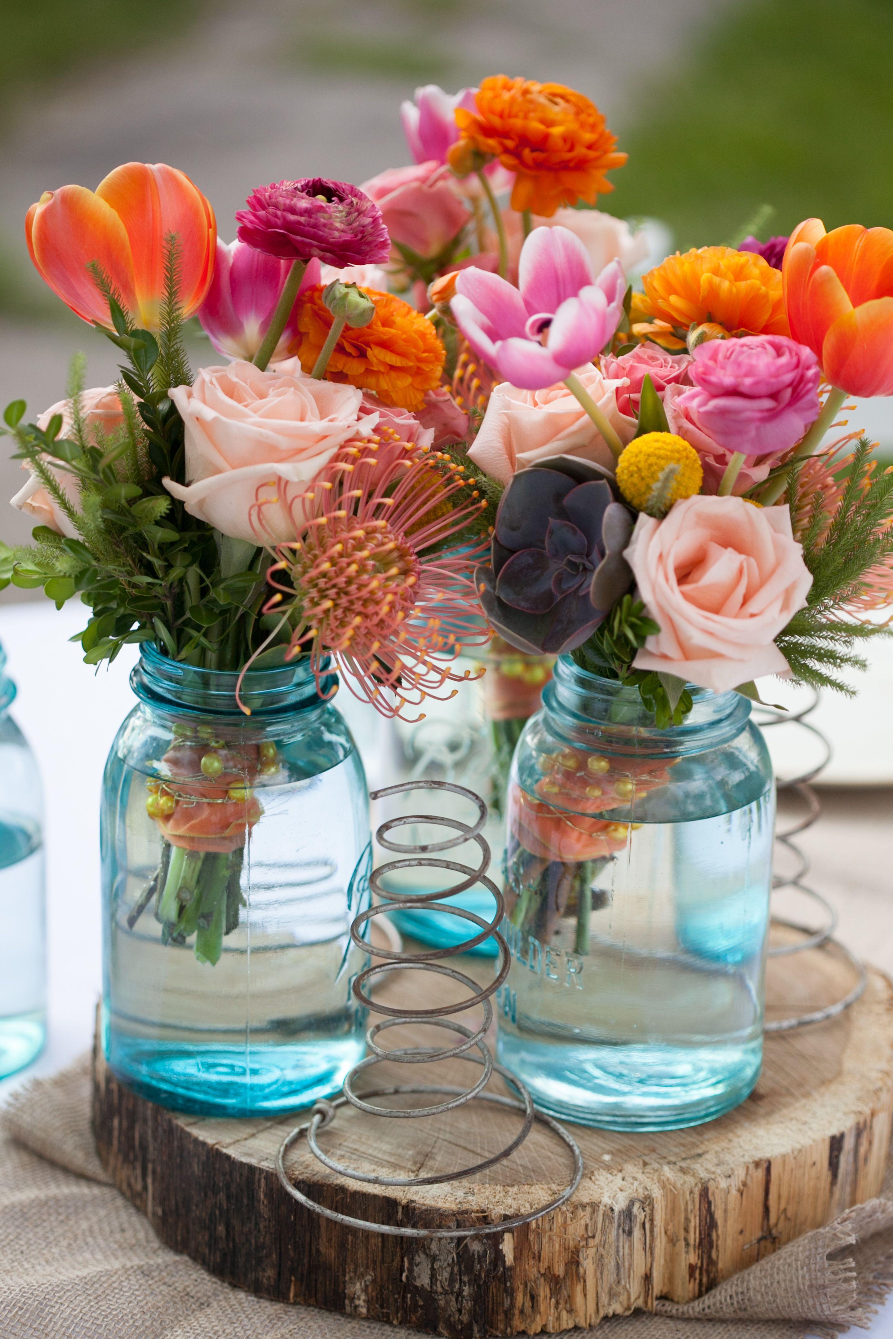 Blue mason jarfilled wedding reception centerpieces wedding decor