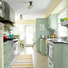 1918 Craftsman Bungalow After Remodel Galley Kitchen With Pro Style Appliances Linoleum Flooring