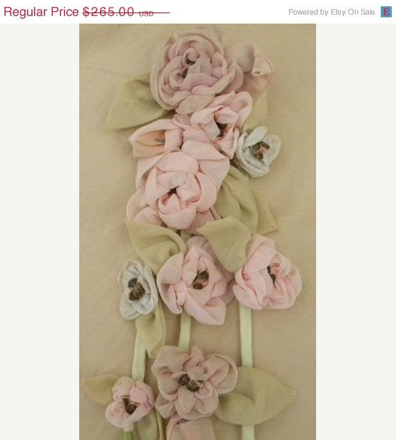 This is a very chic, 1920s cascading, ribbonwork applique featuring a feminine, pastel, coral pink and pale blue chiffon roses/rosette buds and pale
