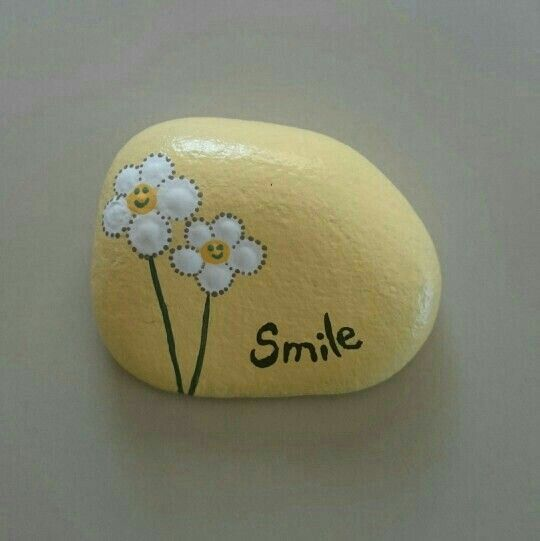 """""""Smile"""" and flowers painted on a stone                                                                                                                                                                                 More"""