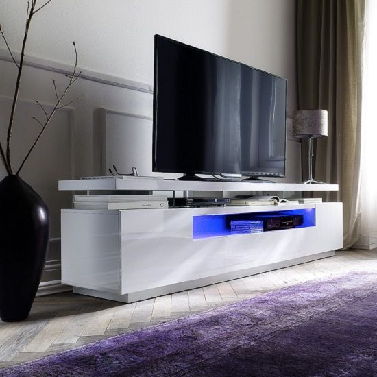 avelin lcd tv stand in white high gloss with 3 drawers and led lighting makes a