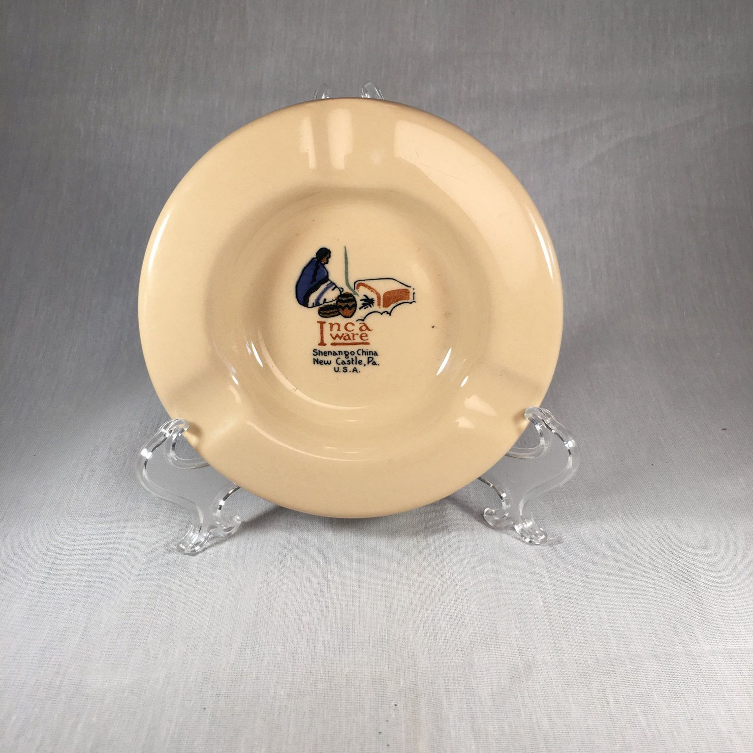 shenango top marked advertising ashtray multi color inca ware