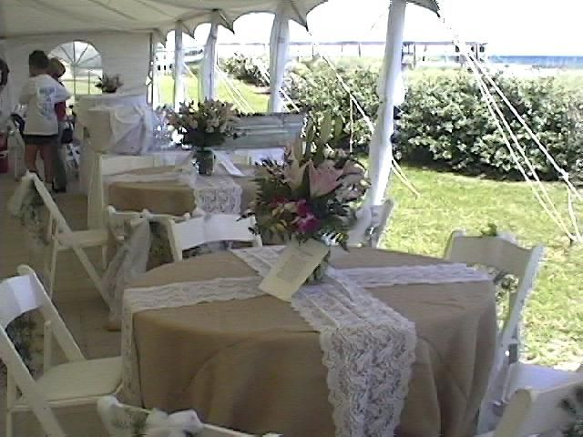 Beautiful Round Tables And Linen Under Wedding Canopy Using Cathedral Window  Sidewalls.