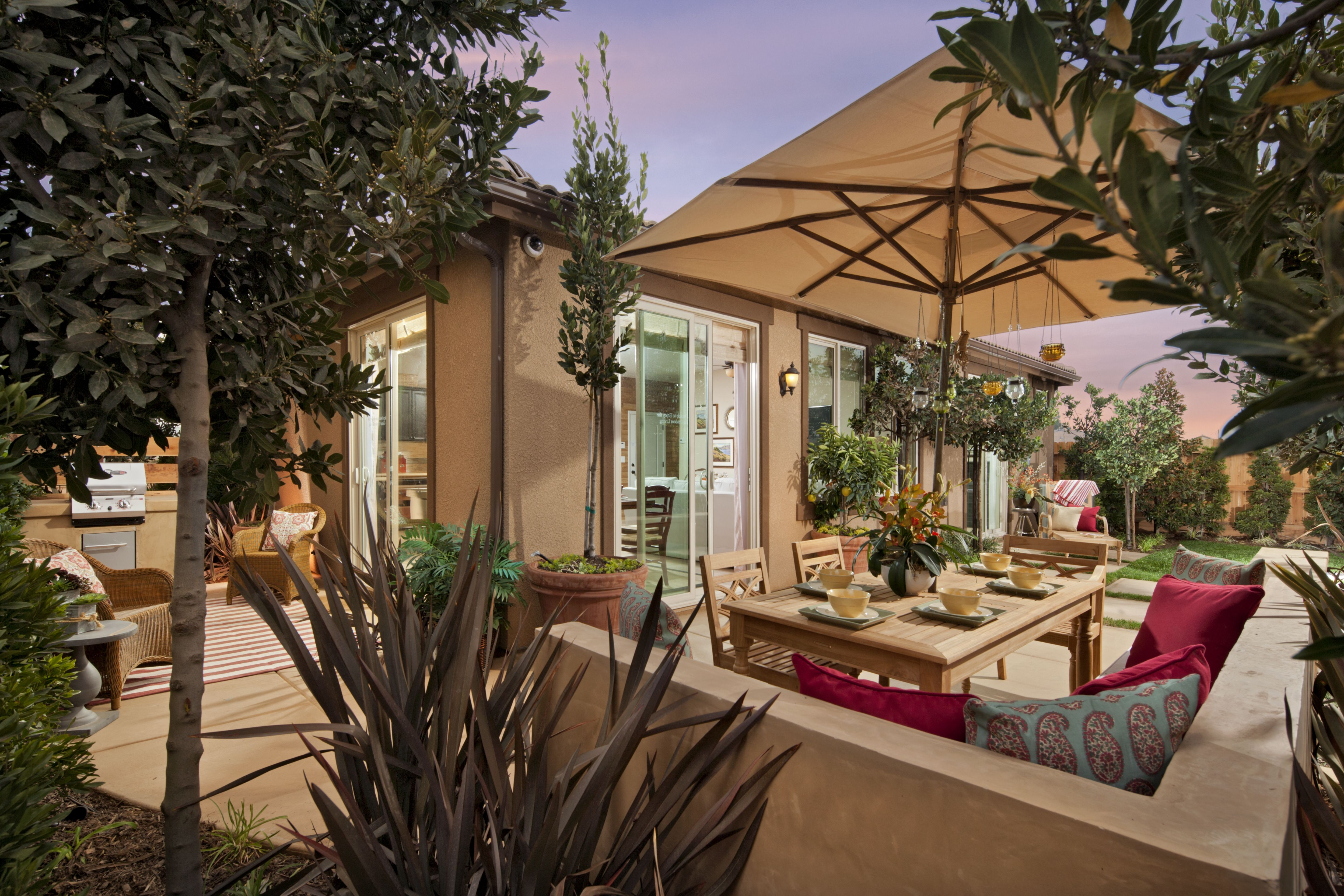 The Outdoor Living Space In The Chelsea Model Is Gorgeous It Is Decorated With Bright Pops Of Pink And Outdoor Living Space Outdoor Living New Homes For Sale