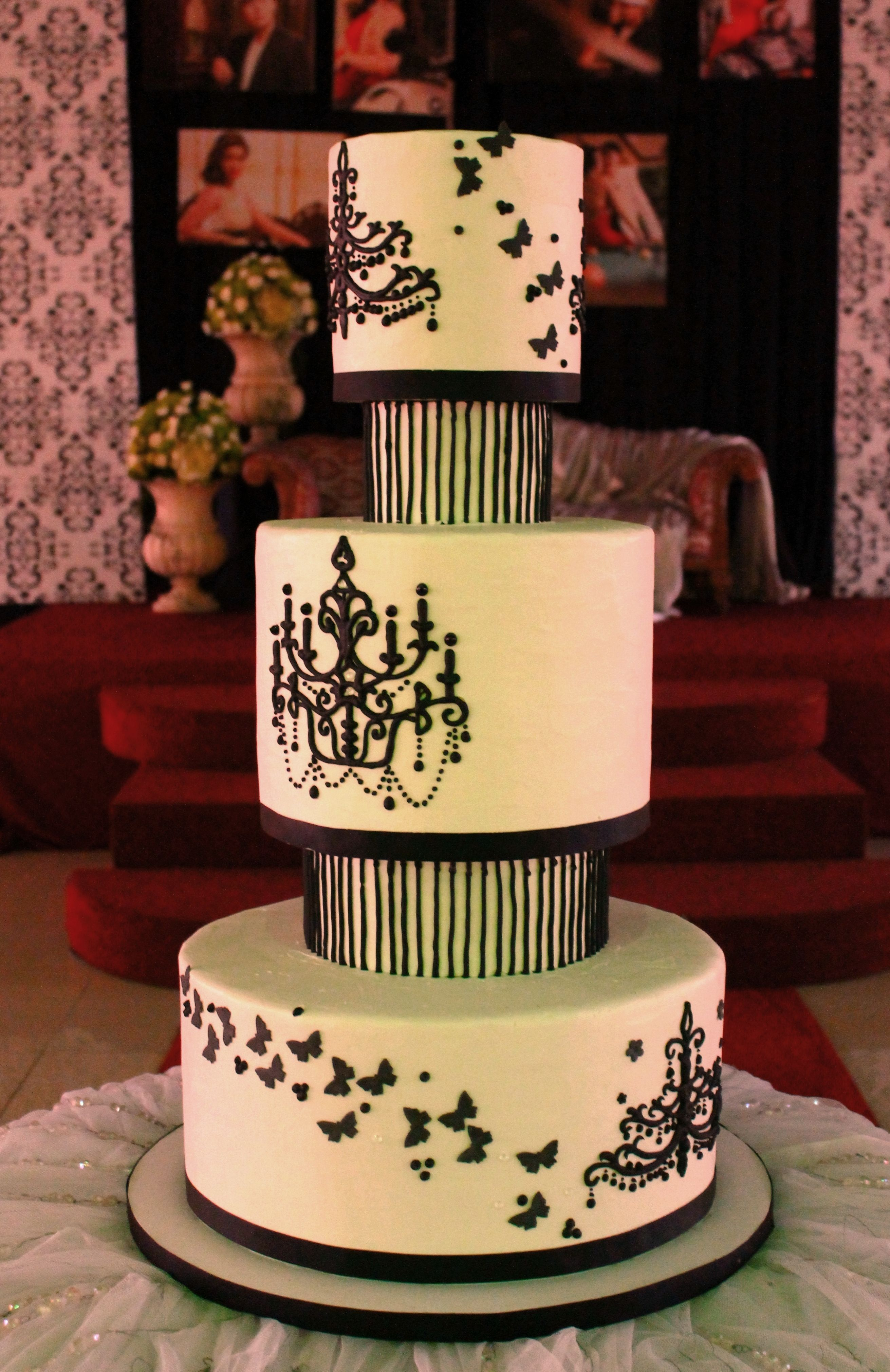 3 Layer Wedding Cake With Separators In Buttercream Icing Black Chandelier And Stripe Piping