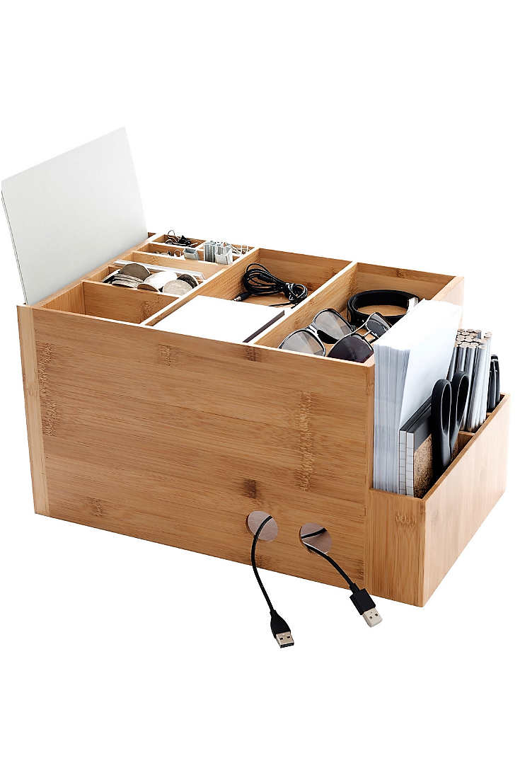 The space cube electronics storage and desk caddy keeps cords tidy