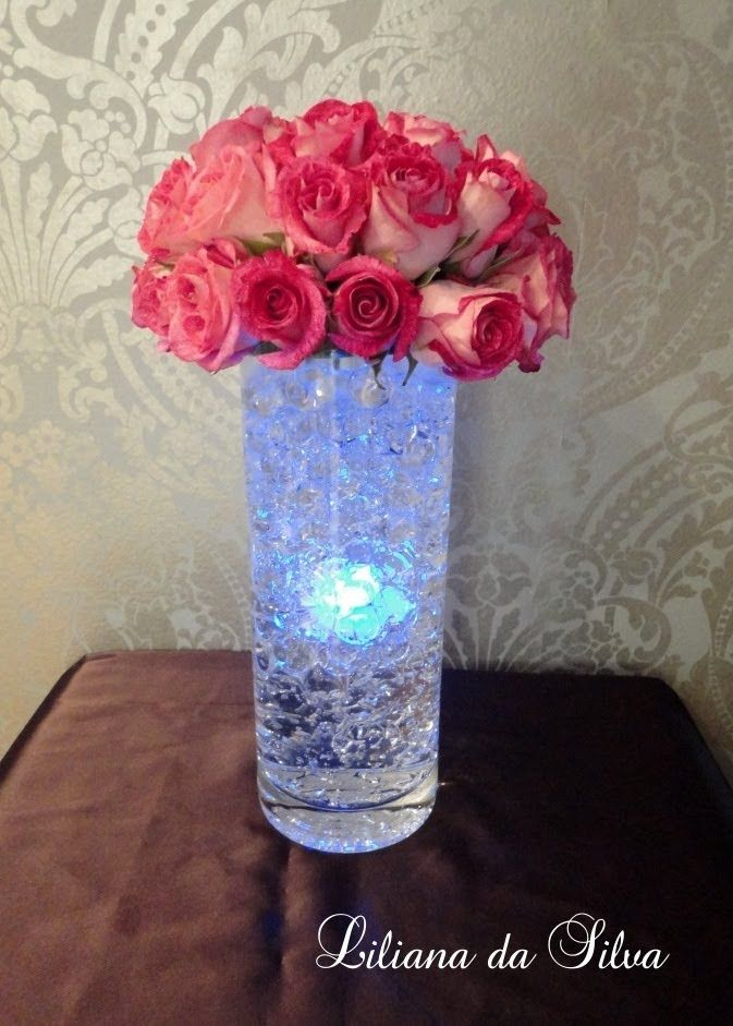 This Led Light Centerpiece Tutorial Will Make Your Table Look Amazing All You Need Is A Clea Glowing Centerpieces Diy Wedding Decorations Lighted Centerpieces