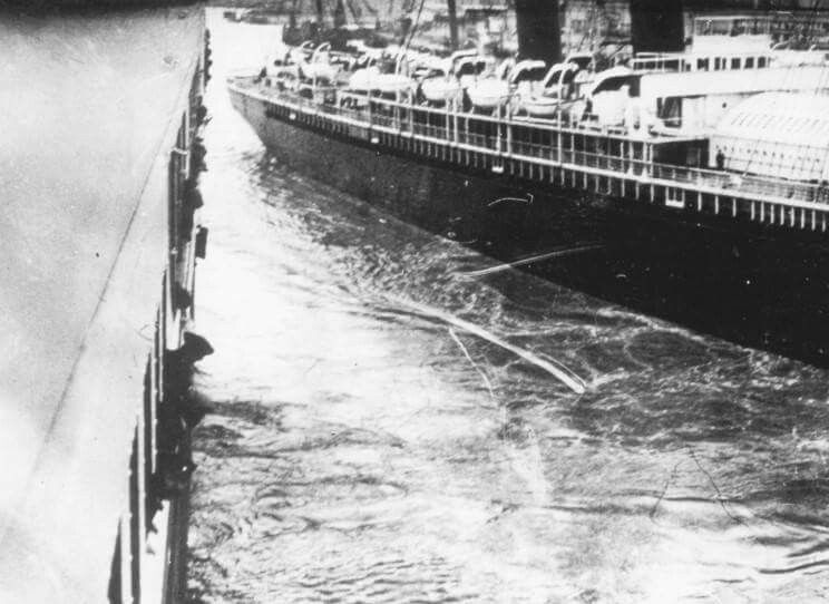 Photo showing Titanic left, with the New York, right, narrowly avoiding a collision as she left on her maiden voyage.