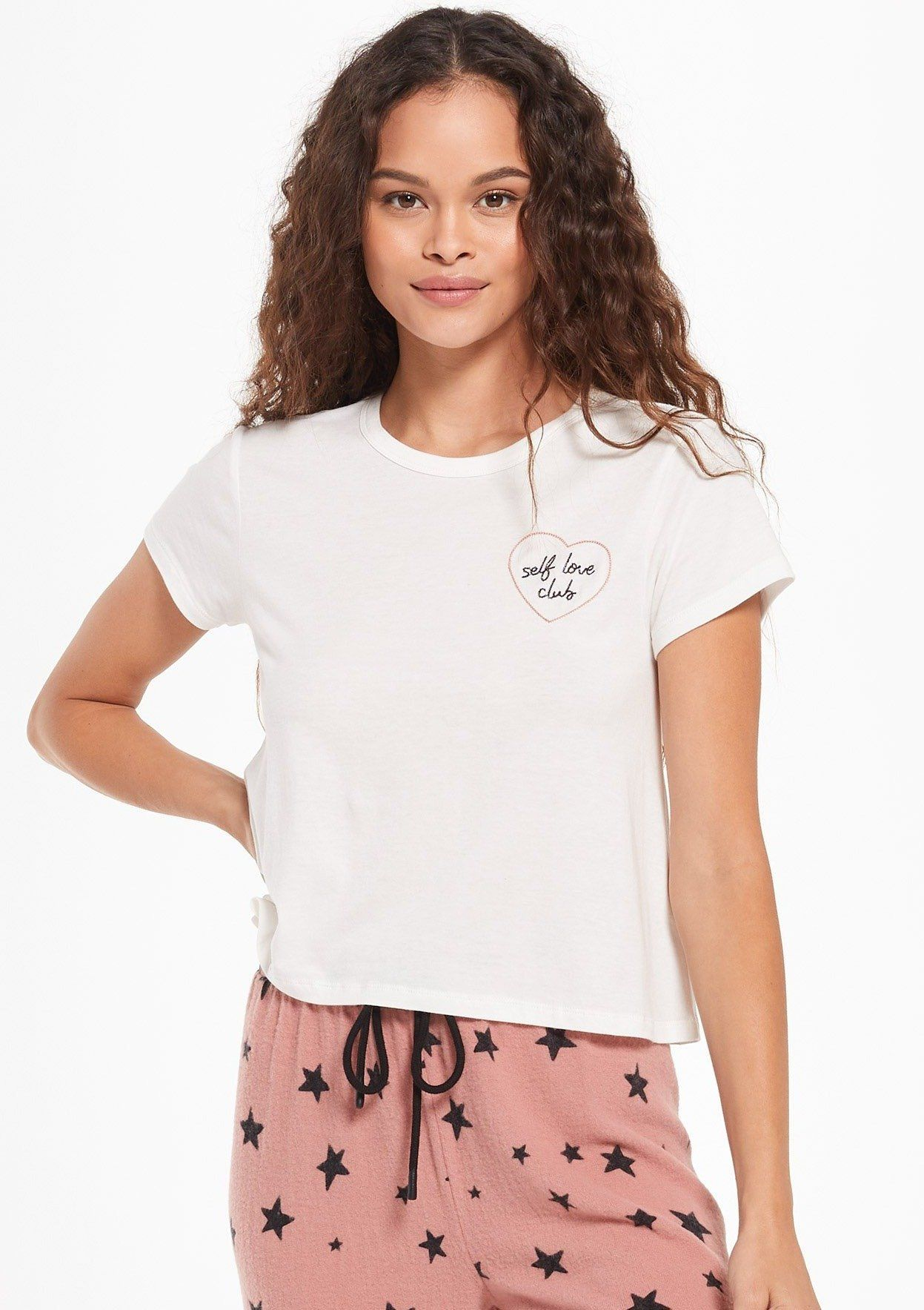 """Join the 'Self Love Club' in Z Supply's AMOR SWING TEE in White. Made using their super soft Cotton Modal Jersey knit fabric, this tee is the perfect mix of comfort and style. It features a heart embroidery with the message """"Self Love Club"""" and matches so many Z Supply Lounge styles."""
