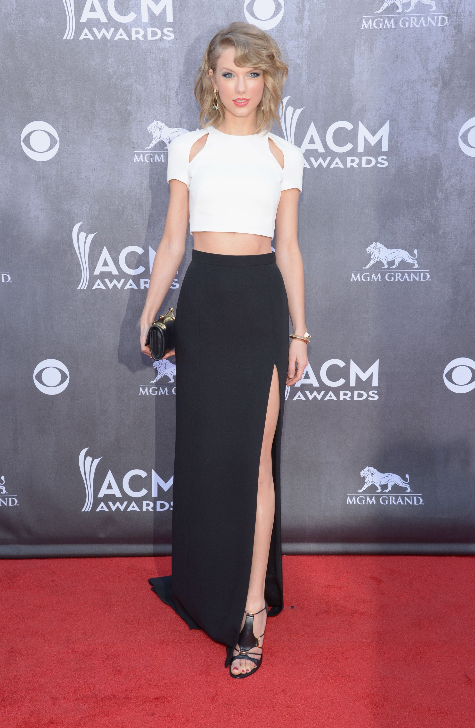 Taylor Swift wearing a custom J. Mendel Silk Crepe Ivory Top and Noir Asymmetrical Skirt to the 49th Annual Academy of Country Music Awards. www.jmendel.com