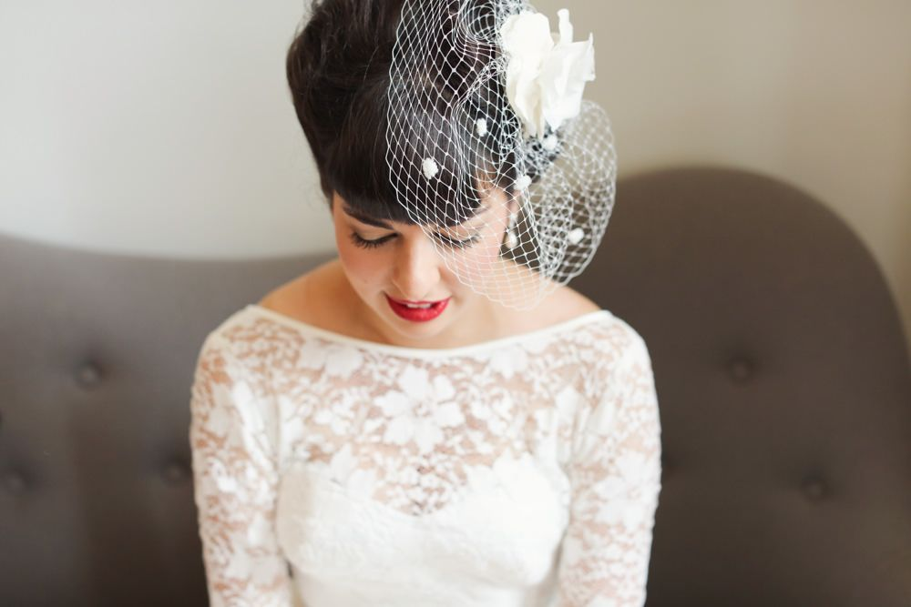 Bride In A Vintage 1950s Short Lace Tea Length Dress With Birdcage Veil For An Urban City Wedding With Bright Red Blue Colour Scheme London Buses And Fabric Wedding