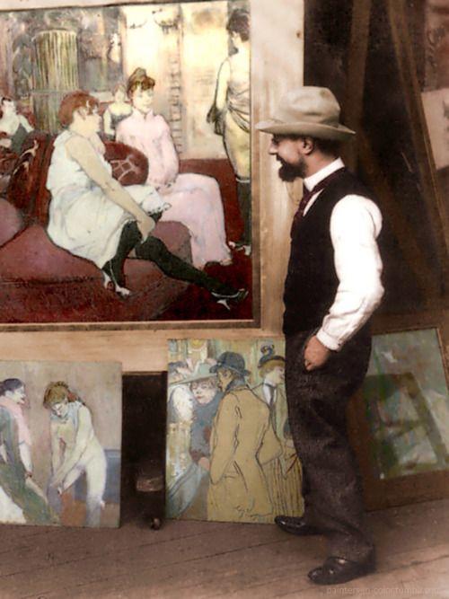 Henri de Toulouse-Lautrec (1864-1901) standing beside his paintings.