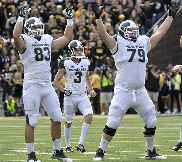 Spartans Linemen Kodi Kieler 79 And Paul Lang 83 Signal The Field Goal Is Good While Michigan State Spartans Football Michigan State Football Msu Football